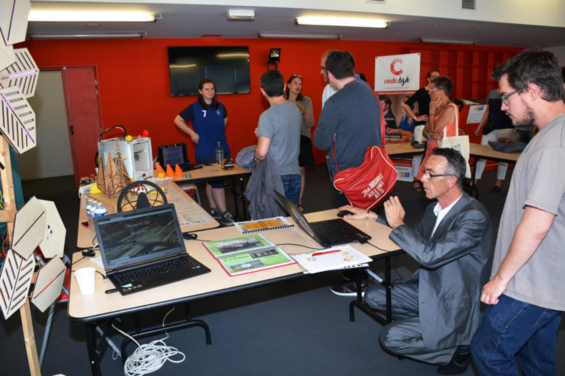 Prospective employees browse stands and displays at the employment event
