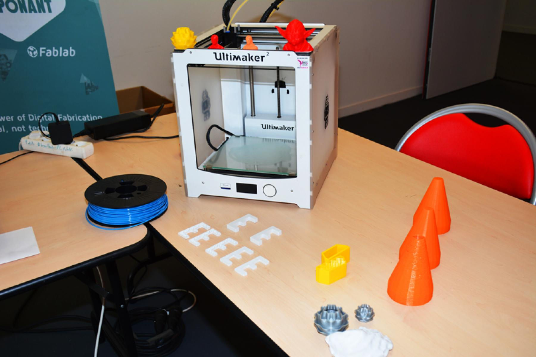 A 3D printer on display in the event's digital space.
