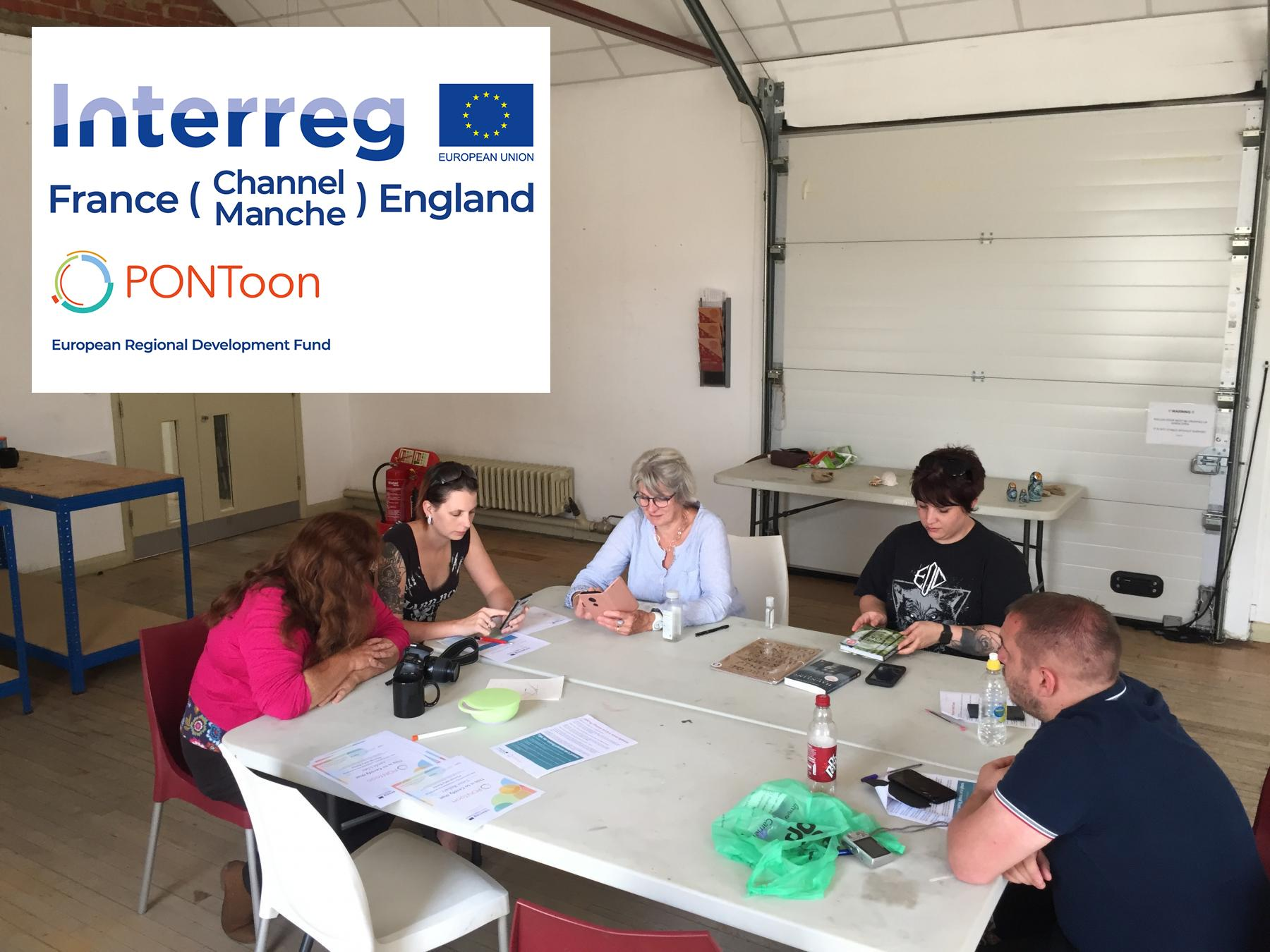 Attendees at PONToon & EBC Photography workshop discuss ideas for photos