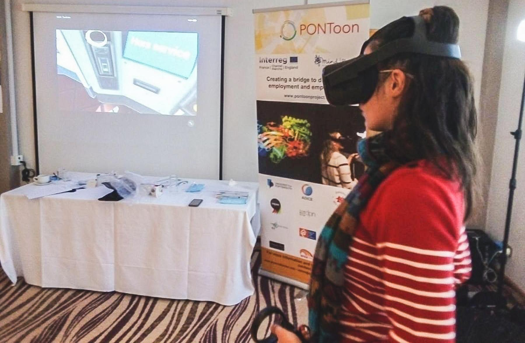 An ambassador for PONToon tries out the Virtual Reality Train Station tool